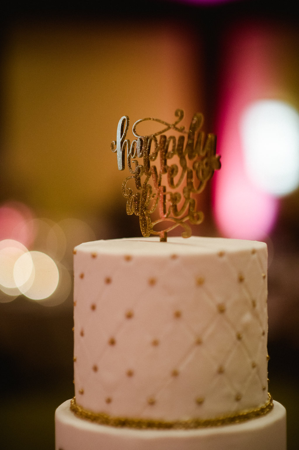 Detail shot of wedding cake created by Bar Cocoa featuring a tufted pattern on the top tier