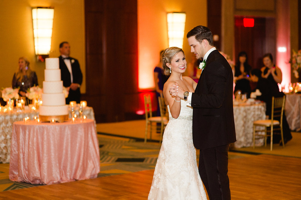 Bride and groom share a first dance to music provided by Sol Fusion and captured by Smitten and Hooked Photography