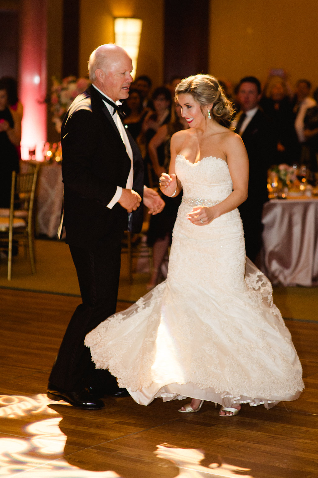 Bride shares a dance with her father to music provided by Sol Fusion during her Uptown Charlotte wedding