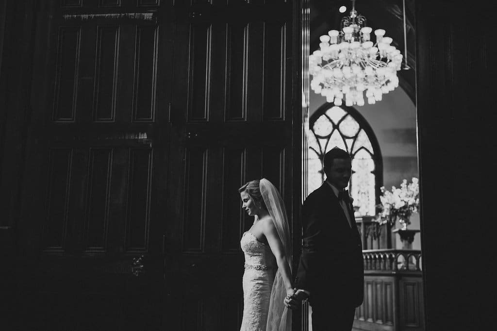 Bride and groom embrace before their wedding ceremony in Charlotte North Carolina