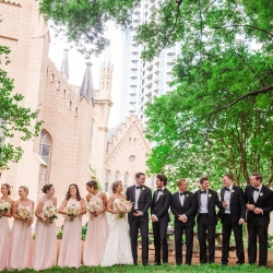 Bride and groom pose with bridal party on the grounds of First Presbyterian Church after their Charlotte North Carolina ceremony