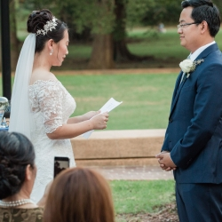 Bride and groom exchange vows during a fall wedding ceremony captured by Soma Photography