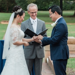 Bride and groom exchange vows during their fall wedding ceremony coordinated by Magnificent Moments Weddings
