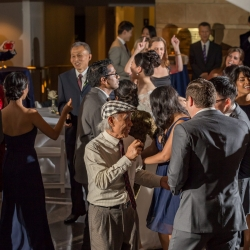 Weddding guests dance to music provided by Huskey AMA Events for a fall wedding at The Mint Museum Randolph