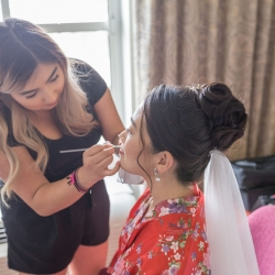 Bride gets hair and make up done as she prepares for her wedding ceremony at The Mint Museum Randolph