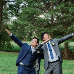 Soma Photography captures a groom celebrating his wedding day with a groomsman at Mint Museum Randolph