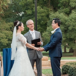 Bride and groom exchange vows during a fall wedding ceremony in Charlotte, North Carolina