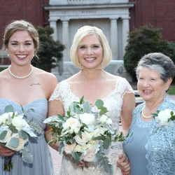 Bride poses with her family before her wedding captured by Strauss Studios