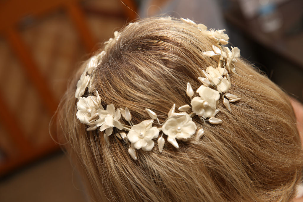 Floral headband accents a brides simple hair style created by Cali Stott Artistry