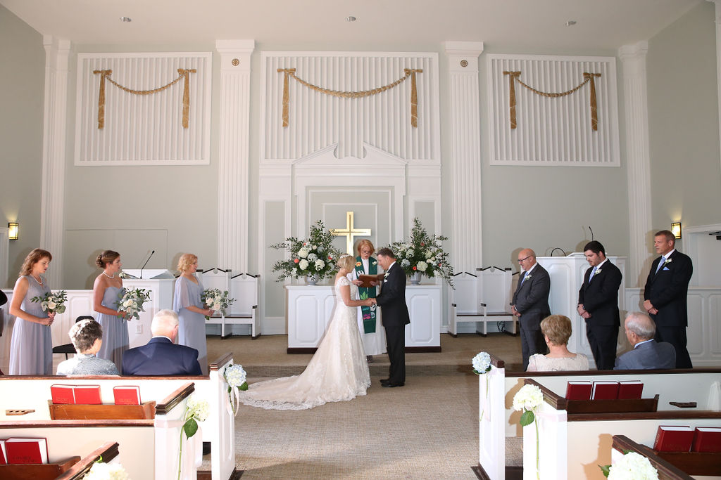 Bride and groom exchange vows in Belk Chapel during their wedding ceremony coordinated by Magnificent Moments Weddings