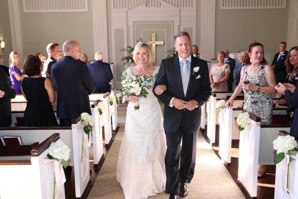 Bride and groom exit their wedding ceremony at Belk Chapel captured by Struass Studios