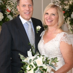 Struass Studios captures a smiling bride and groom after their wedding ceremony at Belk Chapel