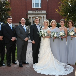 Bride and groom pose with their bridal party outside of Belk Chapel captured by Strauss Studios