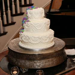Three tier cake featuring a delicate scroll pattern for a wedding at Charlotte City Club