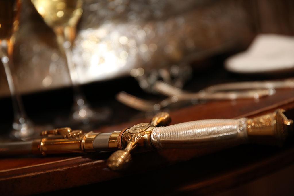 Groom's military sword used for cake cutting captured by Strauss Studios during a wedding at Charlotte City Club
