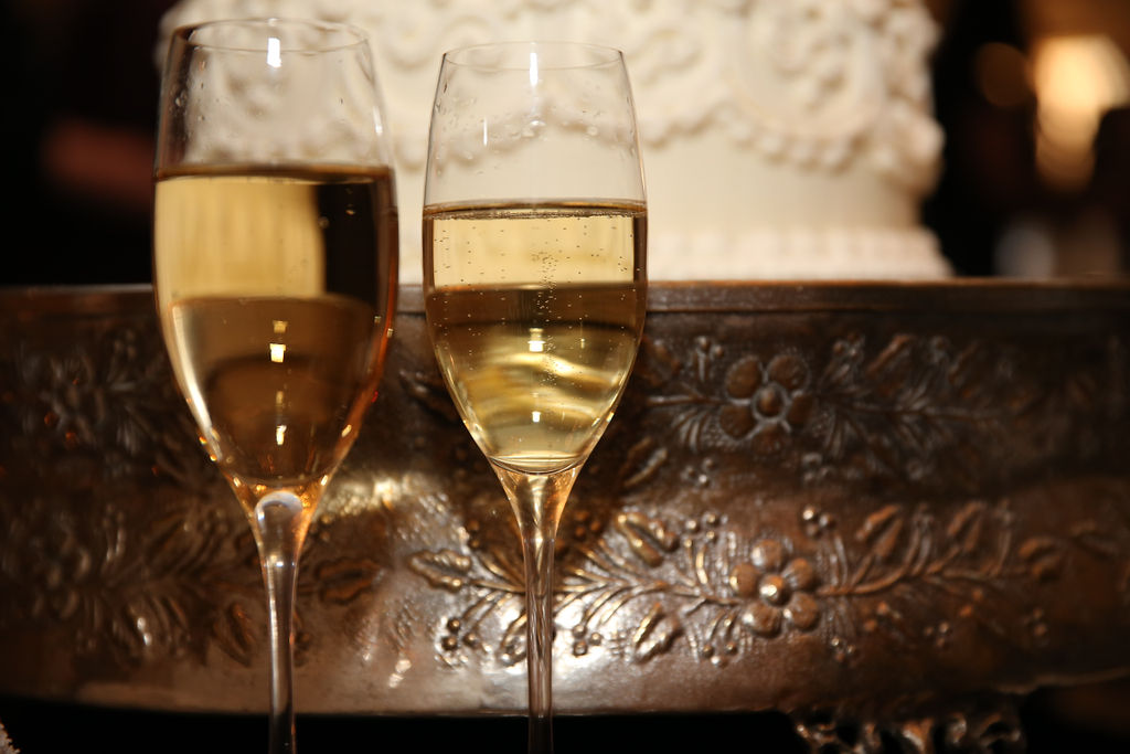 The couple enjoyed a champagne toast during their reception at Charlotte City Club coordinated by Magnificent Moments Weddings