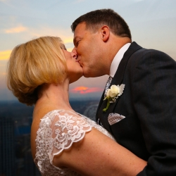 Bride and groom embrace after their wedding ceremony at Belk Chapel in Uptown Charlotte