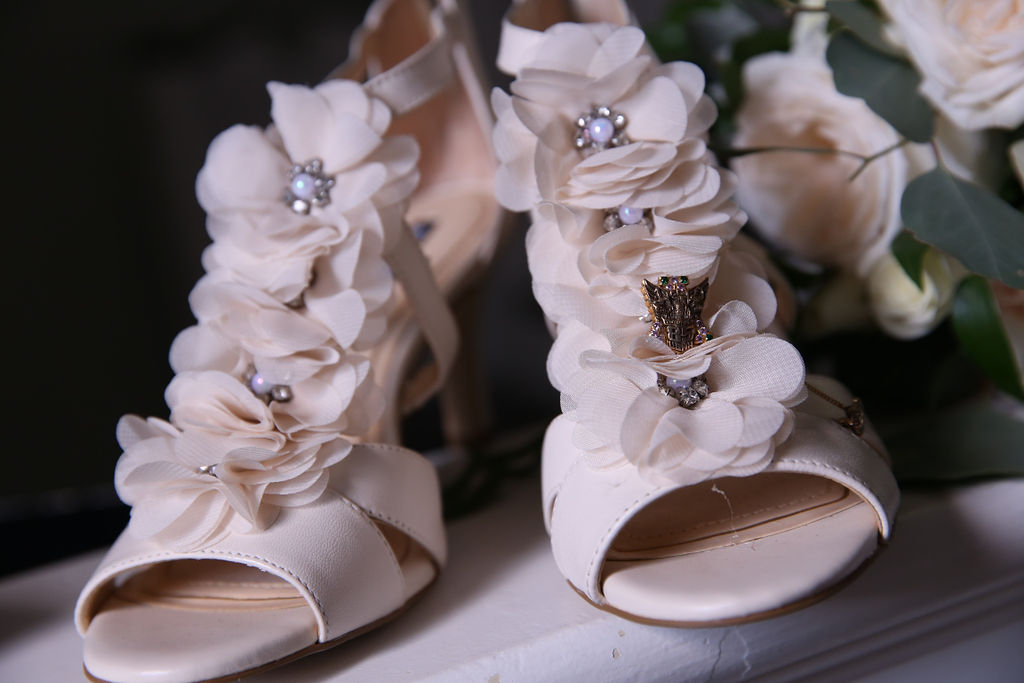 Detail shot of bridal shoes captured by Strauss Studios for a wedding reception at Charlotte City Club