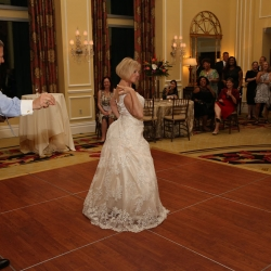 Bride and groom share a fun dance to music provided by Z Brothers during their wedding reception coordinated by Magnificent Moments Weddings