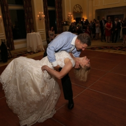 Bride and groom share a first dance dip to music provided by Z Brothers during their Charlotte City Club wedding reception