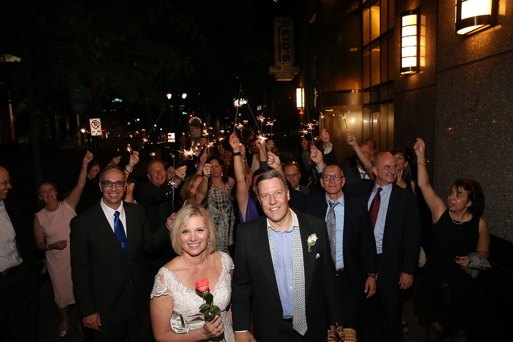 Bride and groom smile after their Charlotte City Club wedding coordinated by Magnificent Moments Weddings