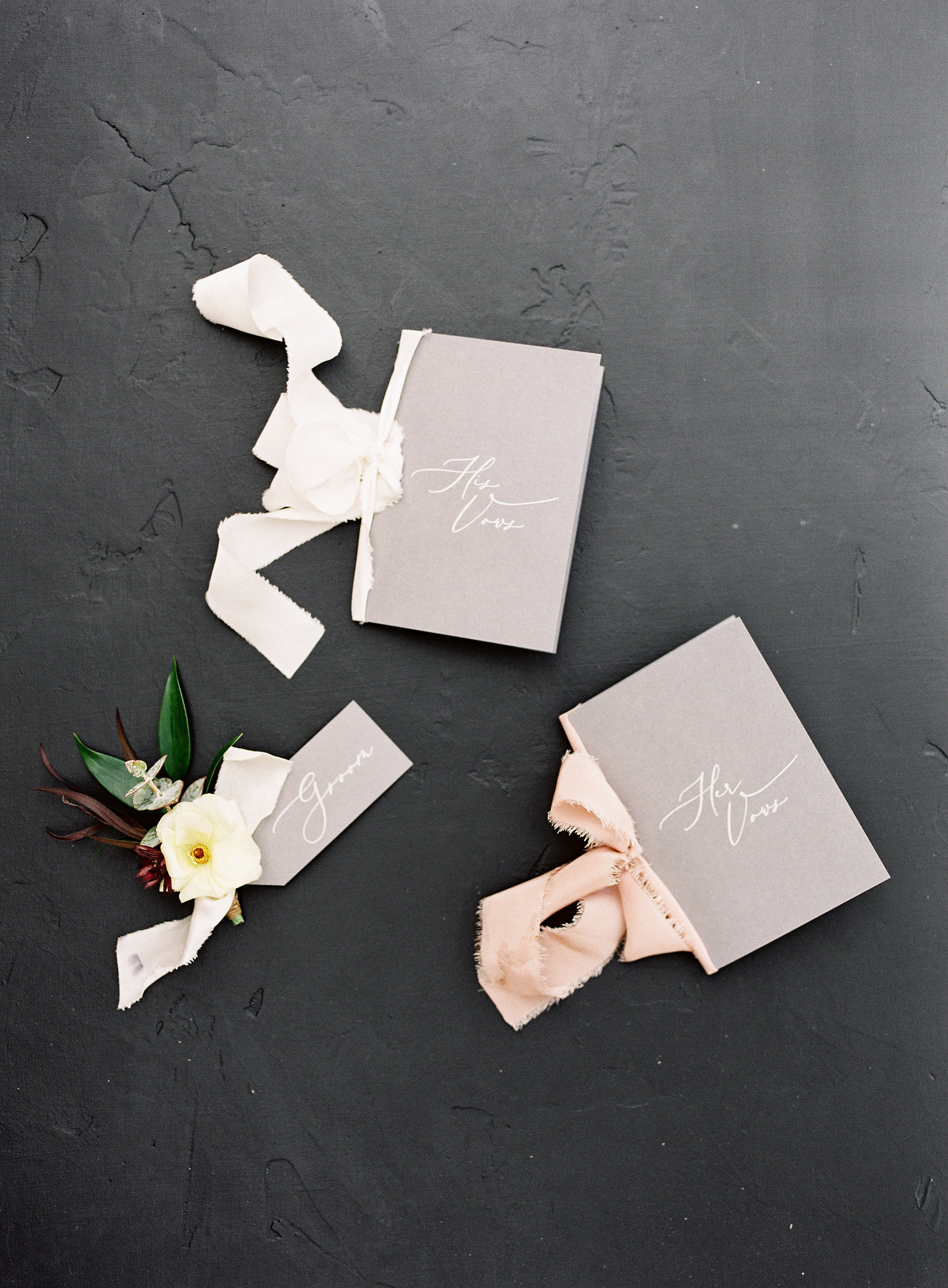 Custom vow booklets by Viri Lovley Designs make for unique keepsakes after a styled shoot designed by Magnificent Moments Weddings
