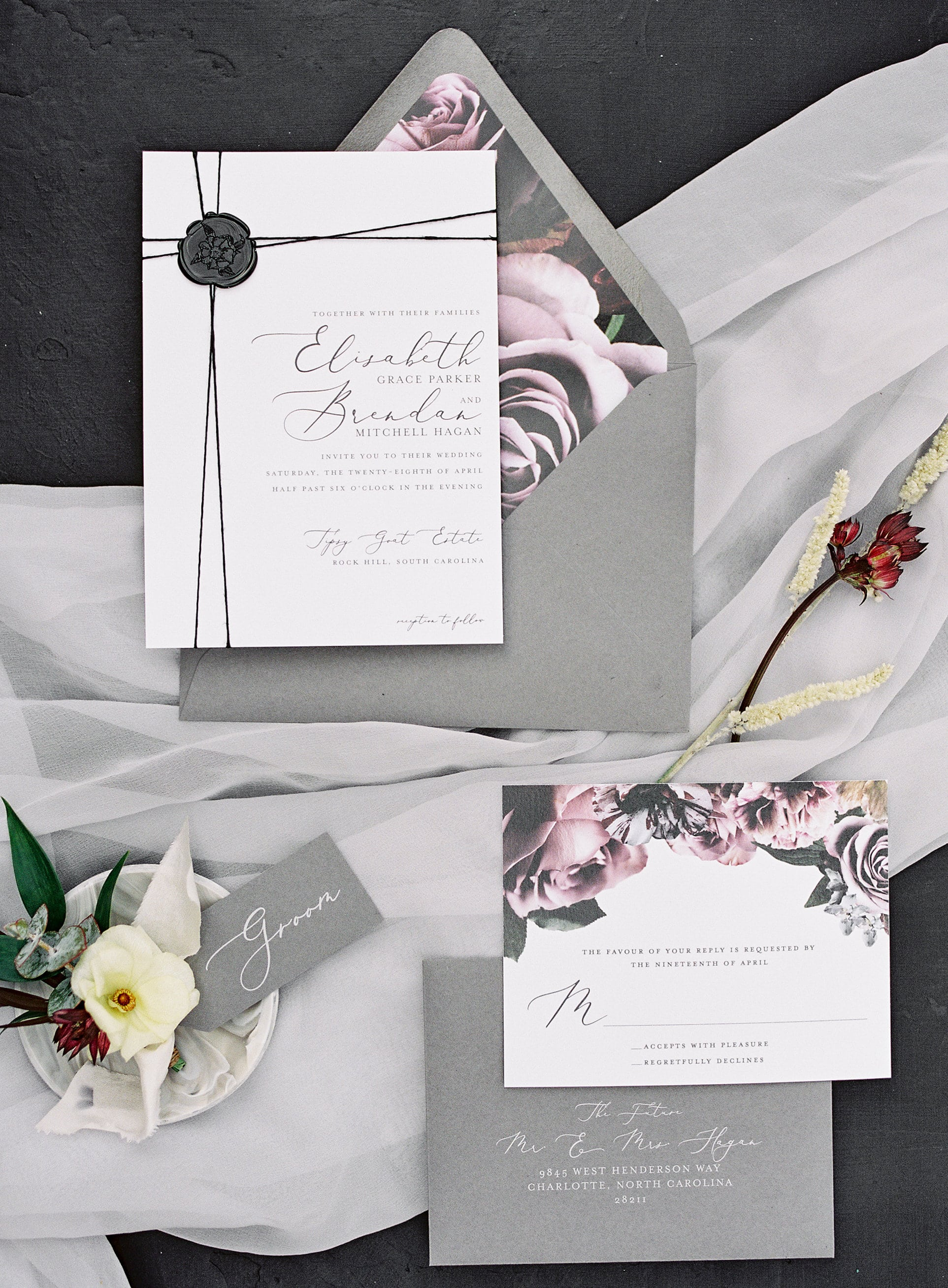 Gray invitation suite features black wax seat and floral envelope lining by Viri Lovley Designs