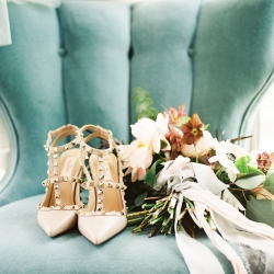 Vintage velvet chair at the Tipsy Goat Estate makes the perfect backdrop for a detail shot of the brides Valentino shoes and stunning bouquet created by Whats Up Buttercup