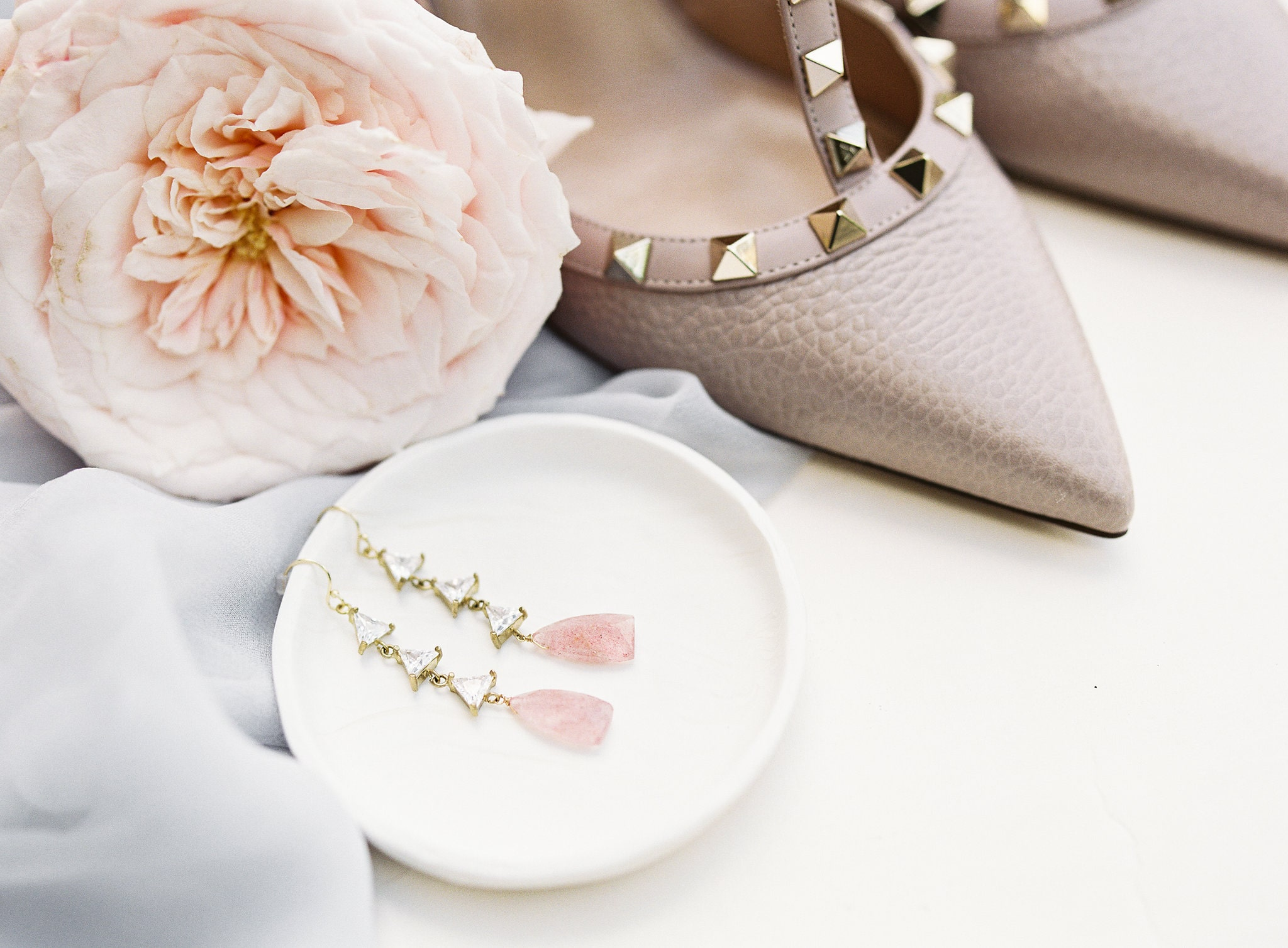 Sunshwoer photography captures detail shot of a brides Valentino shoes and unique earrings from BHLDN