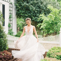Bride twirls in the garden of Tipsy Goat Estate in her dress by Wetter captured by Sunshower Photography