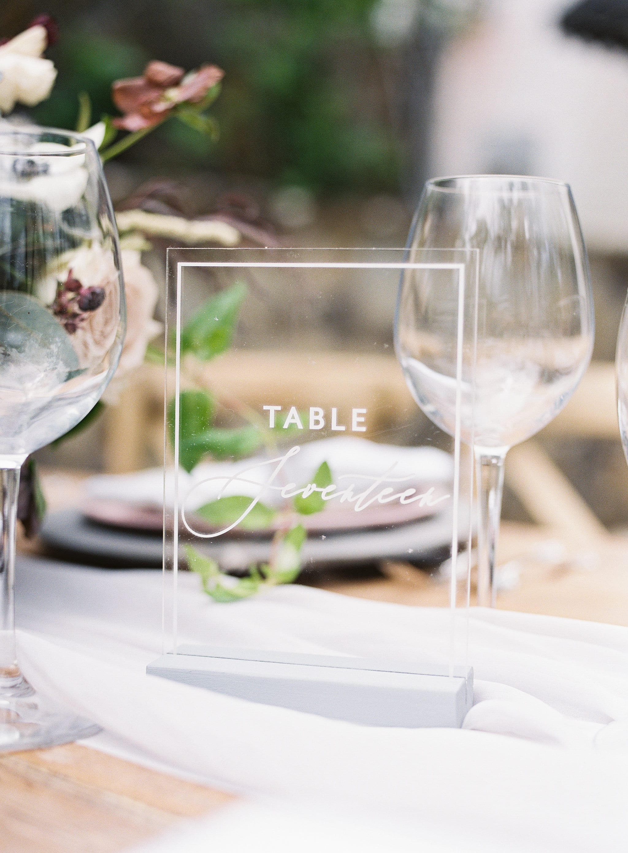 Glass table numbers give a modern twist with traditional script at a styled shoot captured by Sunshower Photography