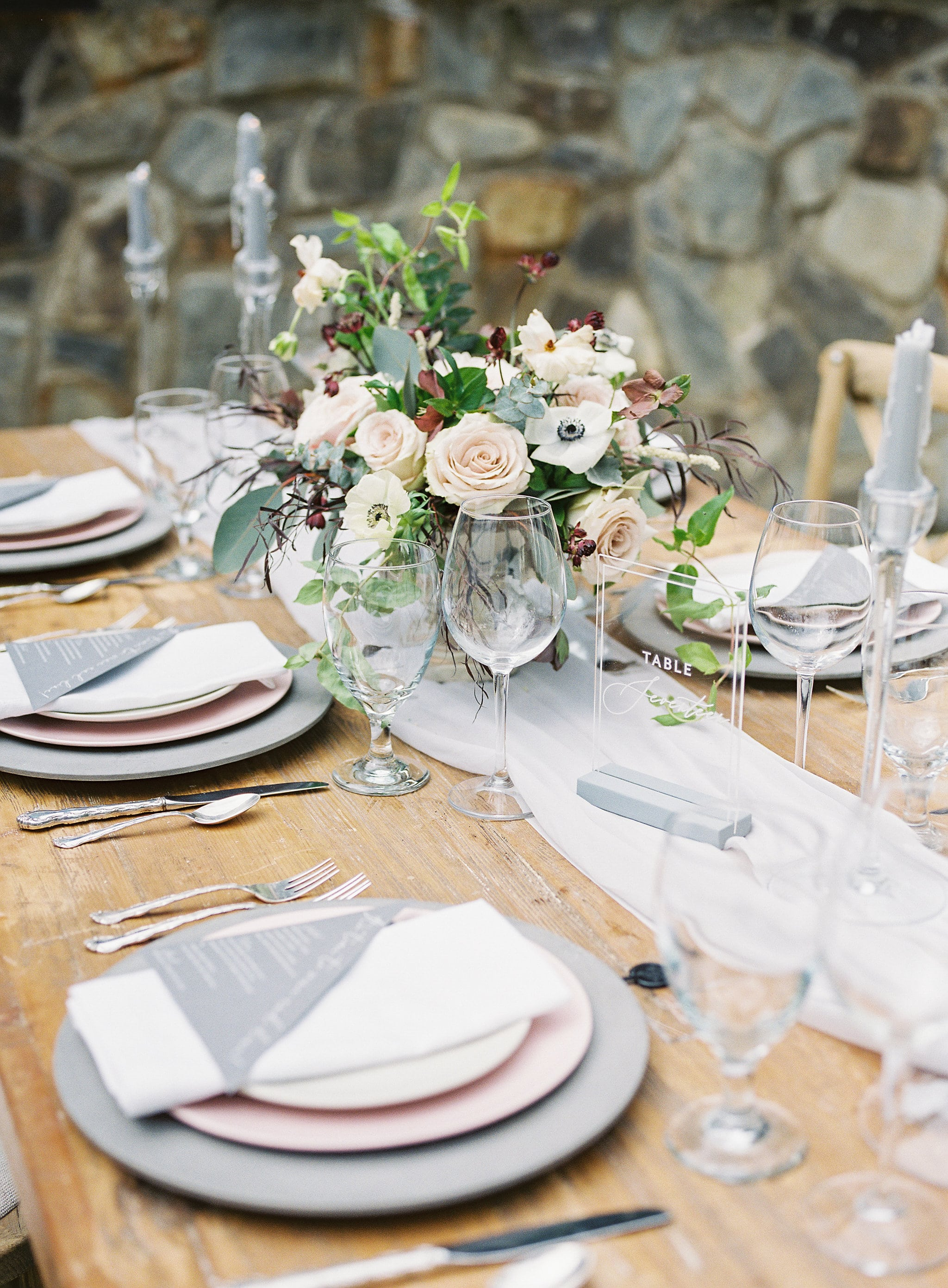 Amazing tablescape has gray details with red accents creates an amazing setting at Tipsy Goat Estates