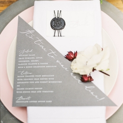 Table setting with gray menu and wax seal place card by Viri Lovely Designs creates a modern romantic effect for a style shoot at Tipsy Goat Estates designed by Magnificent Moments Weddings