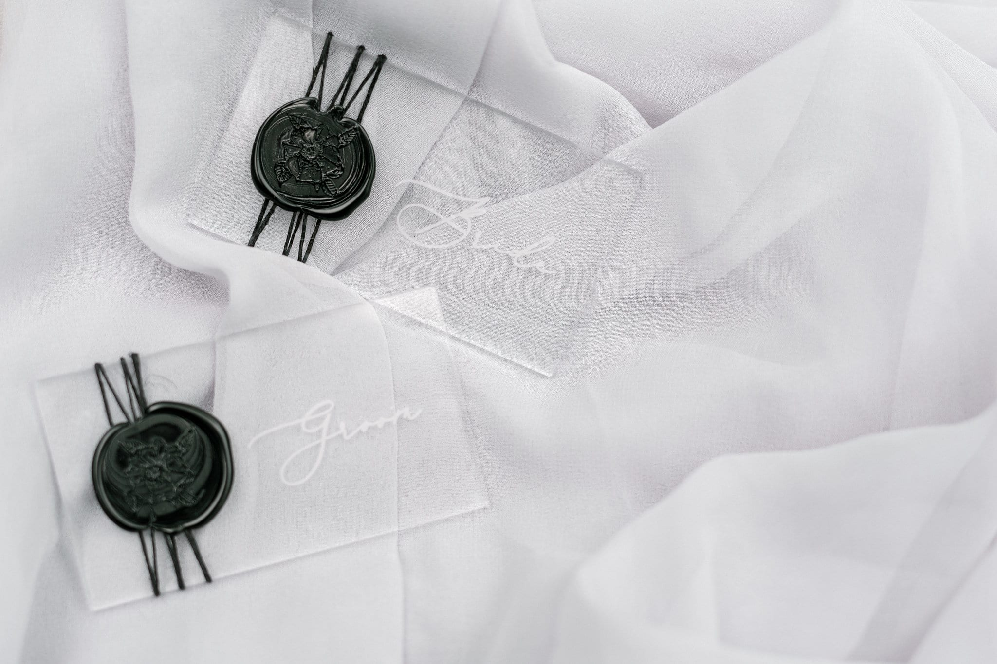 Glass place cards with wax seals create a custom look for a styled shoot at Tipsy Goat Estate