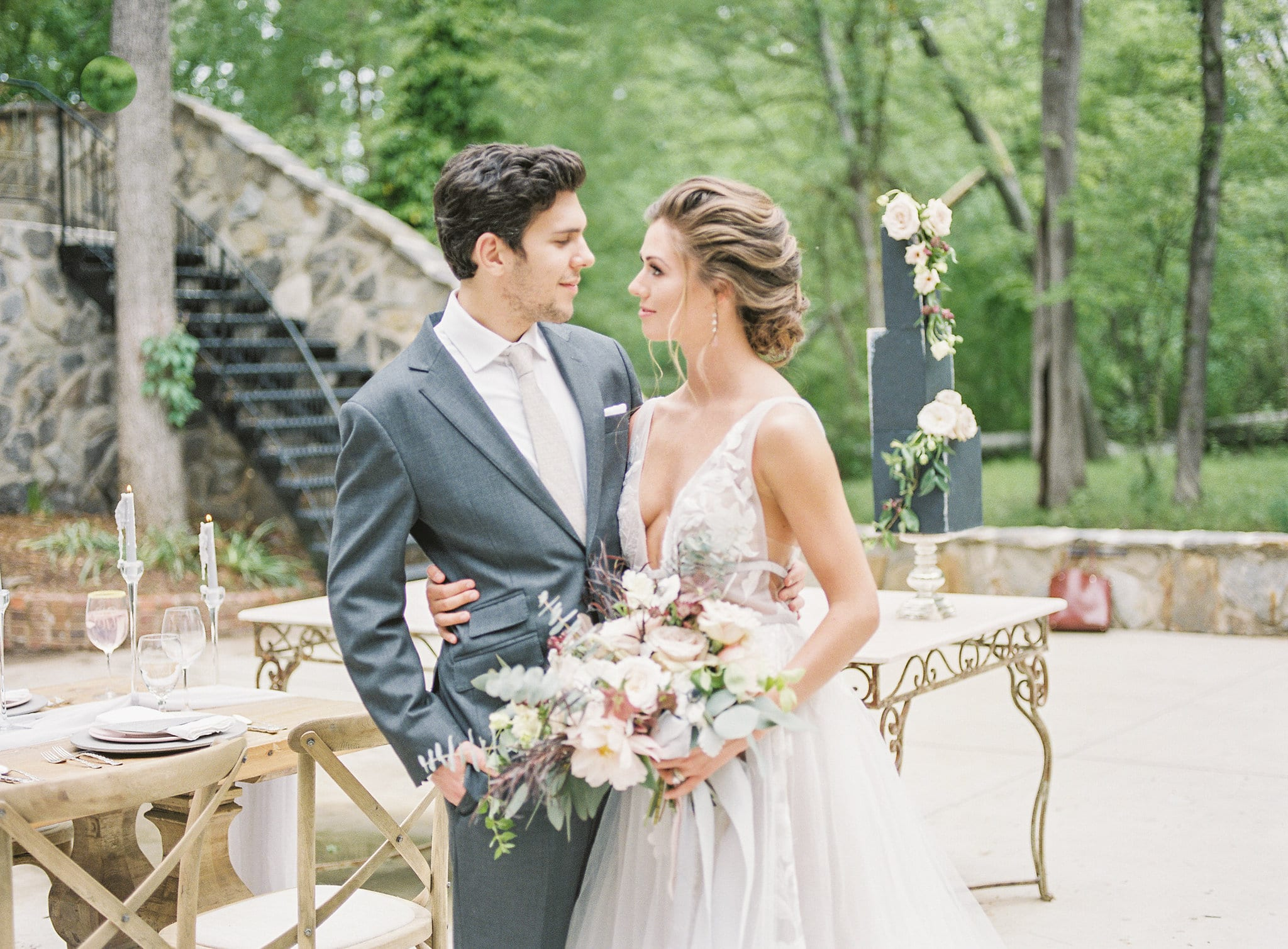 Bride has a sweet updo styled by Jenny Le for a styled shoot at Tipsy Goat Estate captured by Sunshower Photography