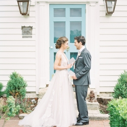 Bride and groom pose in front of a sweet teal door at Tipsy Goat Estate during a styled shoot captured by Sunshower Photography