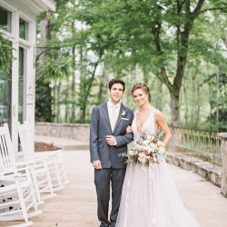 Bride and groom pose on the porch of Tipsy Goat Estate during a styled shoot designed by Magnificent Moments Weddings