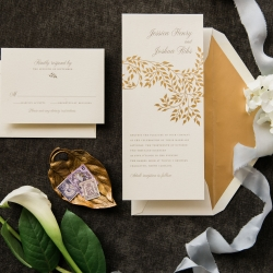 Gold leaf design on a invitation suite by Ocean and Coral Calligraphy for a fall wedding at Triple C Barrel Room