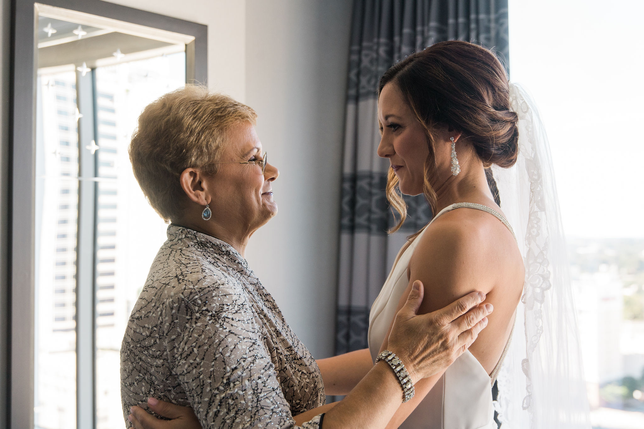 Bride shares a sweet moment with her mother as she prepares for her fall wedding at Triple C Barrel Room