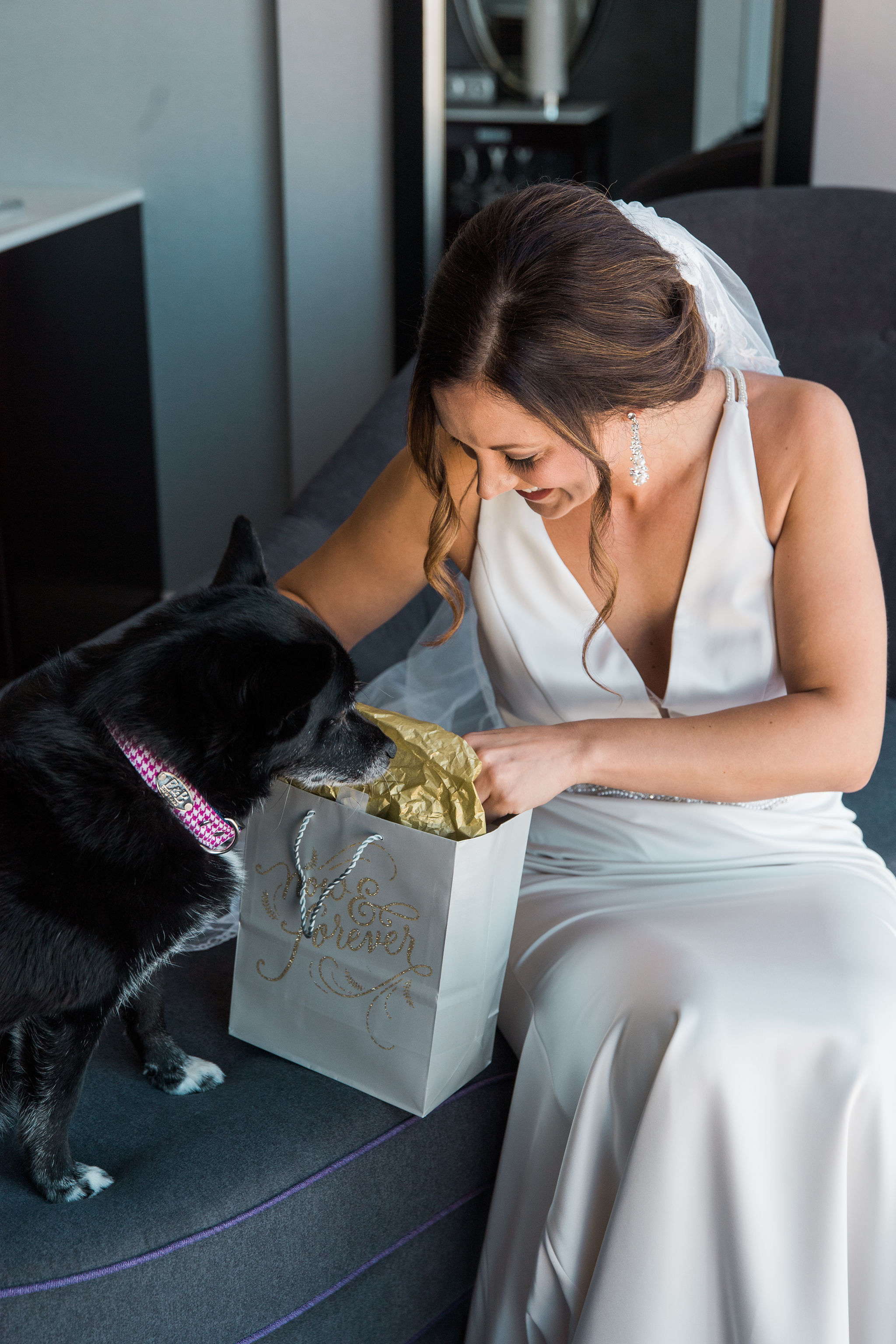 Bride opens a gift from her groom before her fall wedding coordinated by Magnificent Moments Weddings