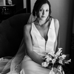 Bride poses with unique bouquet of calla lilies created by Carolyn Shepard Design