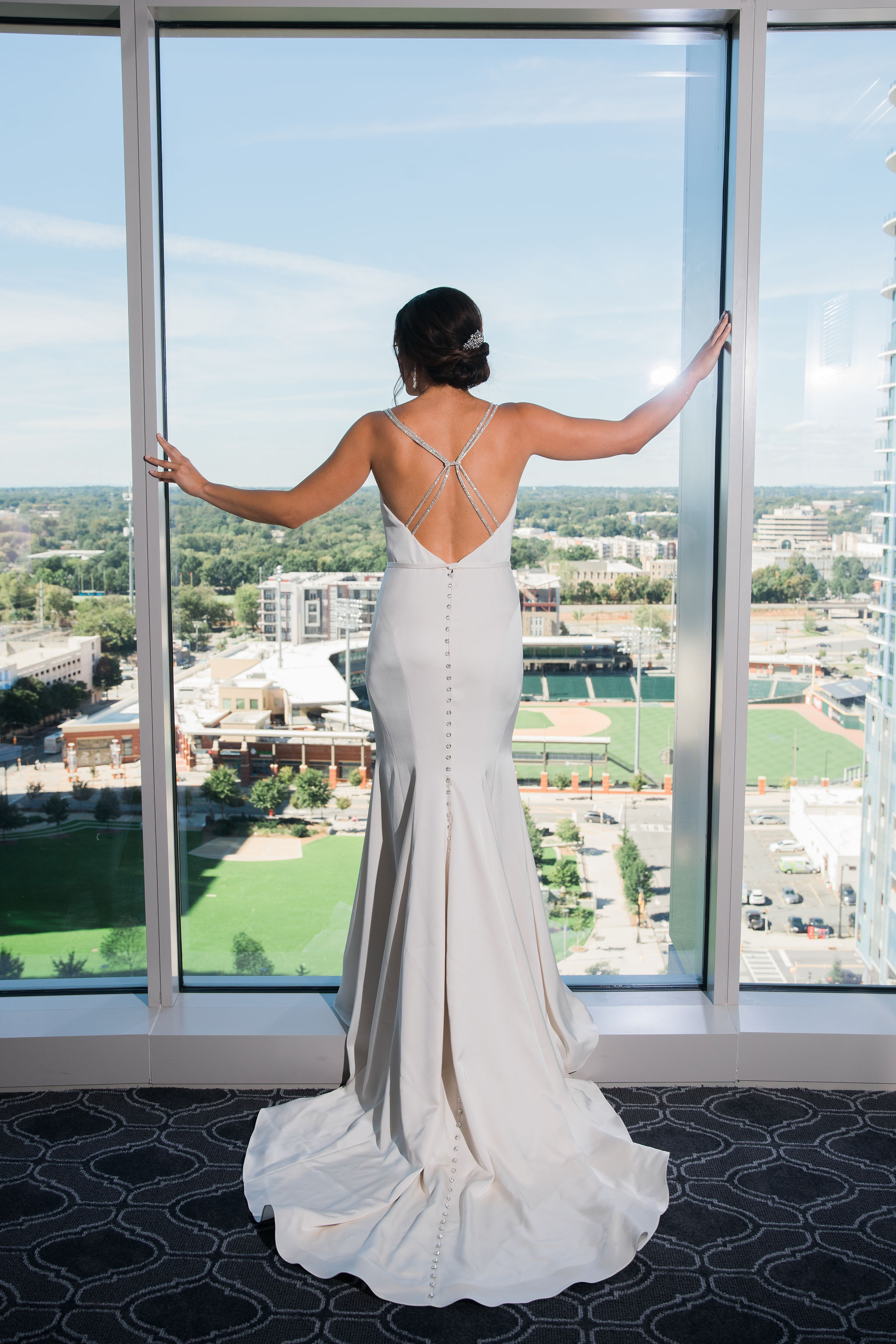 Bride over looks the city from the Kimpton Tryon Park before her wedding captured by Sunshower Photgraphy