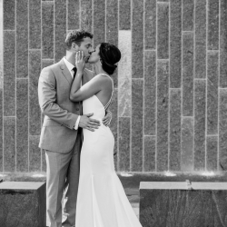 Bride and groom embrace in Uptown Charlotte before their fall wedding at Triple C Barrel Room