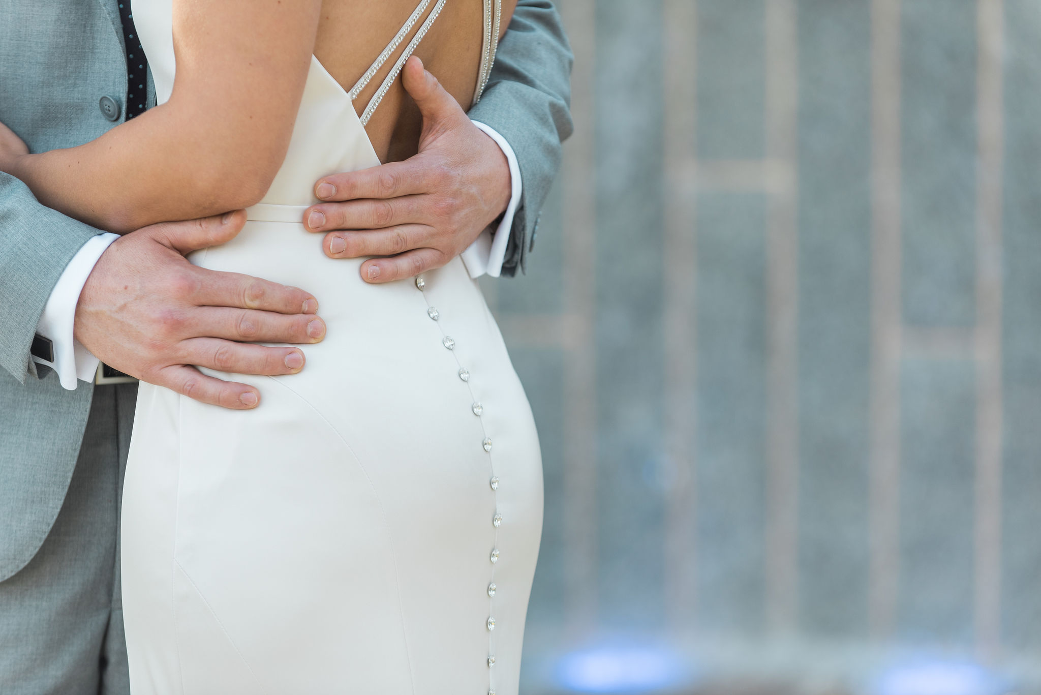 Bride wearing a dress from Poffie Girls with delicate jewel buttons down the back for her fall wedding coordinated by Magnificent Moments Weddings