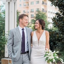 Bride and groom exchange a loving glance after their fall wedding in Uptown Charlotte