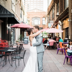 Bride and groom share a sweet kiss captured by Sunshower Photography during their fall wedding in Uptown Charlotte