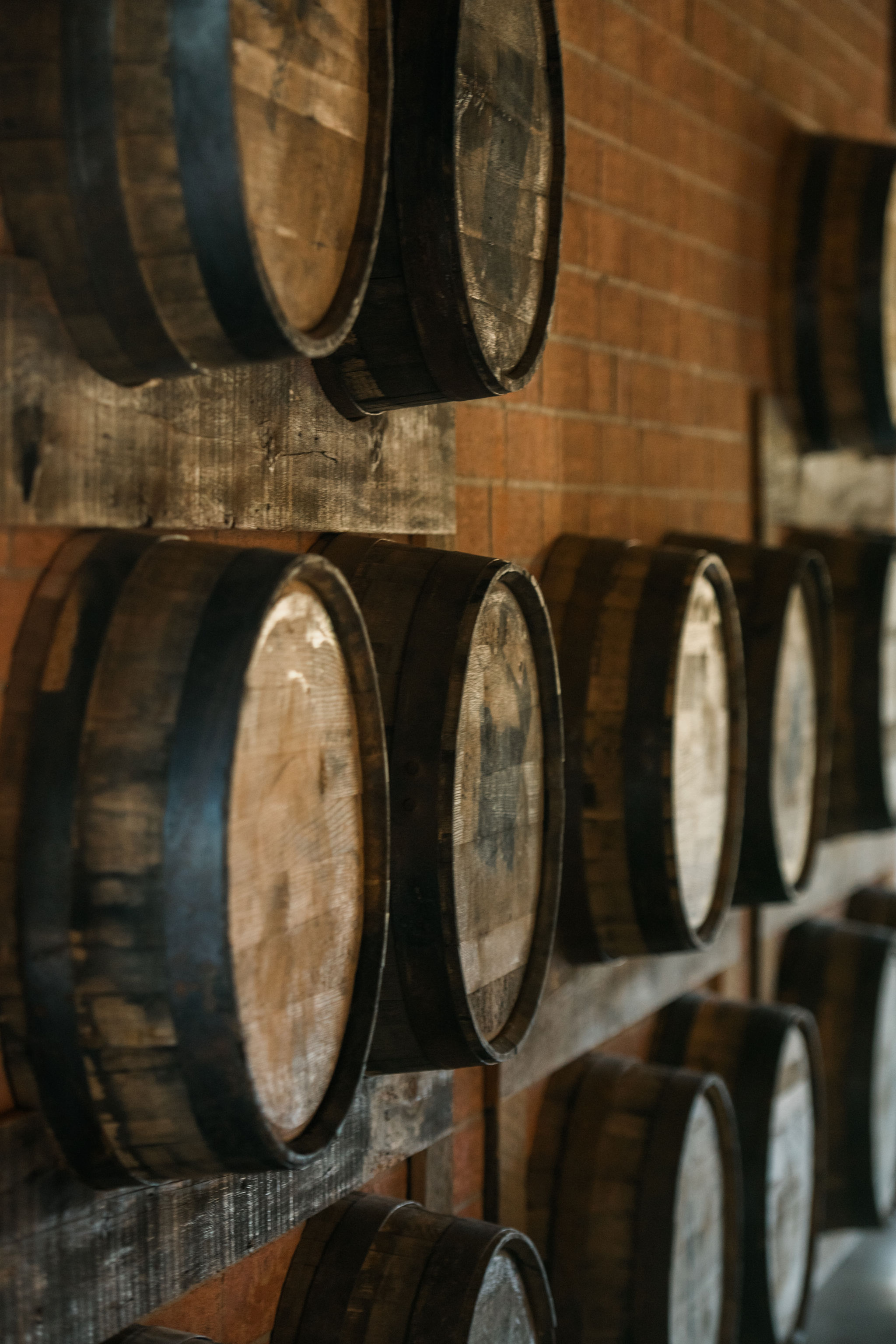Sunshower Photography captures a detail shot of the barrels at Triple C Barrel Room during a fall wedding coordinated by Magnificent Moments Weddings