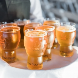 Beer presented to guests at a fall wedding at Triple C Barrel Room