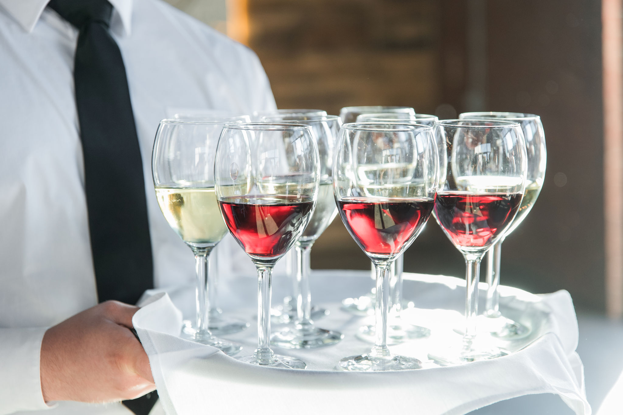 Wine presented to wedding guests during a fall wedding at Triple C Barrel Room