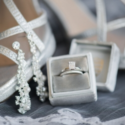 Detail shot of bridal jewelry and shoes captured by Sunshower Photography for a fall wedding at Triple C Barrel Room